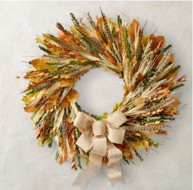 Maple leaves, wheat, feathers with a burlap ribbon from Williams Sonoma